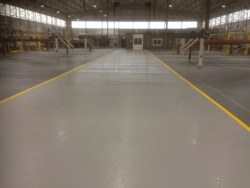 Hangar Resin Flooring Refurbishment. The hangar floor was suffering from heavy degradation