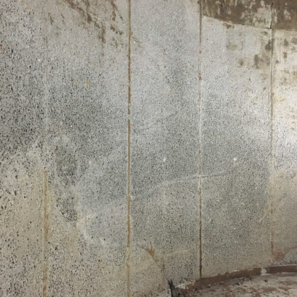 The concrete was prepared by abrasive blasting to remove laitance and contamination.