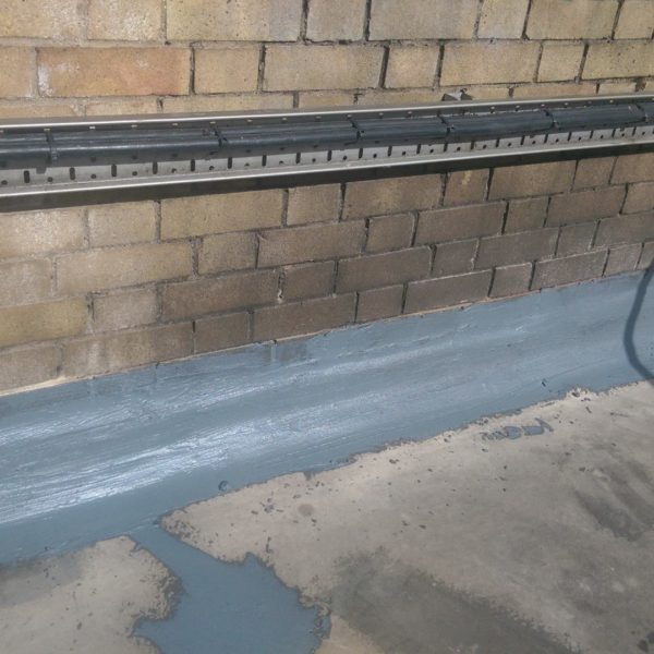 Cracks in the roof were dressed using a vacuum controlled diamond saw prior to sealing using a polyurethane jointing compound.