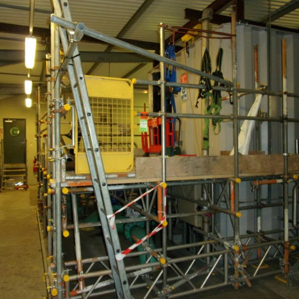 An lifting beam was installed overhead to allow the safe lifting of the floor plates.