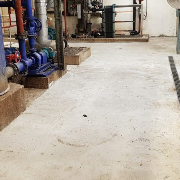 The old tiled floor had largely broken up and numerous old concrete repairs were also failing